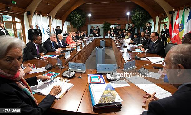 G7 leaders and outreach guests including Managing Director of the International Monetary Fund Christine Lagarde attend a working session with at the...