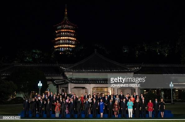 TOPSHOT G20 leaders and their spouses pose for a group photo before their dinner banquet at the G20 Summit in Hangzhou on September 4 2016 World...