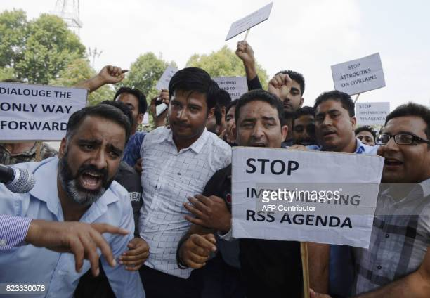Leaders and workers from Kashmir's main opposition party the National Conference shout antigovernment slogans during a protest against civilian...