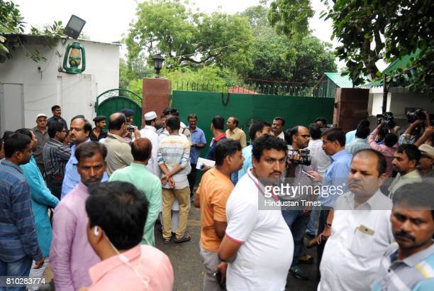 RJD leaders at the entrance to former Railway Minister Lalu Prasad Yadav's residence while the CBI conducts raids on July 7 2017 in Patna India The...