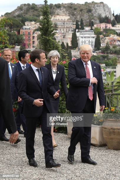 G7 leaders French President Emmanuel Macron speaks with US President Donald Trump as they attend a flypast at San Domenico Palace Hotel on May 26...