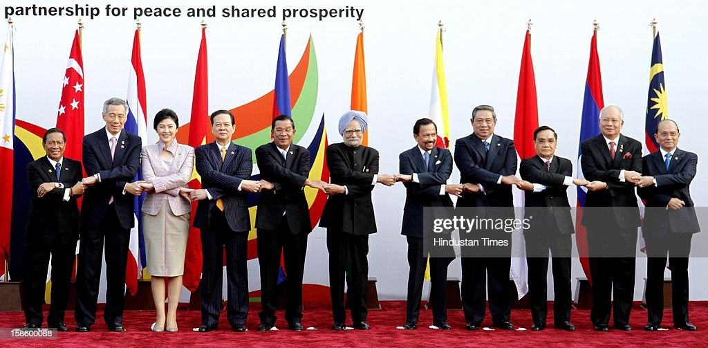 ASEAN leaders from right, Thein Sein, President Mayanmar, Mohd Najib bin Tun Abdul Razak, Vice President of Malaysia, Dr. Susilo Bambang Yudhoyono, Prime Minister of Laos PDR, Thongsing Thammavong, Prime Minister of Indonesia, Haji Hassanal Bolkiah Mu'izzadin Waddaulah, Sultan of Brunai Darussalam, Indian Prime Minister Manmohan Singh, Cambodian Prime Minister Hun Sen, Vietnamese Prime Minister Nguyen Tan Dung, Thailand Prime Minister Yinluck Shinawatra, Singaporean Prime Minister Hsien Loong Lee, and Philippines Vice President Jejomar Binay at the group photo session during the ASEAN - India Commemorative Summit, 2012 at Taj Palace Hotel on December 20, 2012 in New Delhi, India.