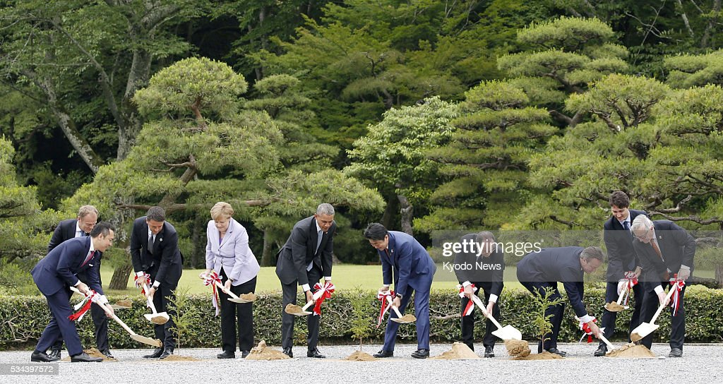 Leaders from the Group of Seven major economies, representatives of the European Union and the governor of Mie Prefecture plant trees on May 26, 2016, the first day of the G-7 summit meeting, at Ise Jingu shrine in the central Japan city of Ise. (From L) They are Mie Gov. Eikei Suzuki, European Council President <a gi-track='captionPersonalityLinkClicked' href=/galleries/search?phrase=Donald+Tusk&family=editorial&specificpeople=870281 ng-click='$event.stopPropagation()'>Donald Tusk</a>, Italian Prime Minister <a gi-track='captionPersonalityLinkClicked' href=/galleries/search?phrase=Matteo+Renzi&family=editorial&specificpeople=6689301 ng-click='$event.stopPropagation()'>Matteo Renzi</a>, German Chancellor <a gi-track='captionPersonalityLinkClicked' href=/galleries/search?phrase=Angela+Merkel&family=editorial&specificpeople=202161 ng-click='$event.stopPropagation()'>Angela Merkel</a>, U.S. President <a gi-track='captionPersonalityLinkClicked' href=/galleries/search?phrase=Barack+Obama&family=editorial&specificpeople=203260 ng-click='$event.stopPropagation()'>Barack Obama</a>, Japanese Prime Minister <a gi-track='captionPersonalityLinkClicked' href=/galleries/search?phrase=Shinzo+Abe&family=editorial&specificpeople=559017 ng-click='$event.stopPropagation()'>Shinzo Abe</a>, French President Francois Hollande, British Prime Minister <a gi-track='captionPersonalityLinkClicked' href=/galleries/search?phrase=David+Cameron+-+Politician&family=editorial&specificpeople=227076 ng-click='$event.stopPropagation()'>David Cameron</a>, Canadian Prime Minister <a gi-track='captionPersonalityLinkClicked' href=/galleries/search?phrase=Justin+Trudeau&family=editorial&specificpeople=2616495 ng-click='$event.stopPropagation()'>Justin Trudeau</a> and European Commission President <a gi-track='captionPersonalityLinkClicked' href=/galleries/search?phrase=Jean-Claude+Juncker&family=editorial&specificpeople=207032 ng-click='$event.stopPropagation()'>Jean-Claude Juncker</a>.