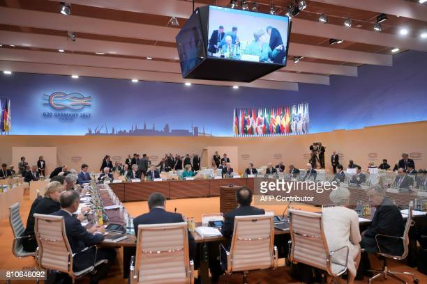 G20 leaders have taken seat for another working session during the G20 summit in Hamburg northern Germany on July 8 2017 Leaders of the world's top...