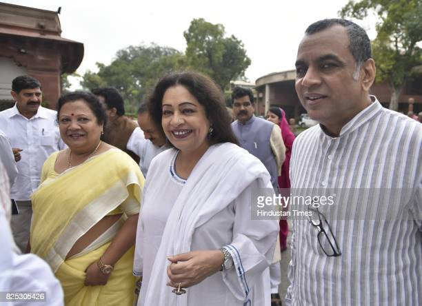 BJP leaders Kirron Kher and Paresh Rawal with others coming out after attending the Parliamentary Party Meeting during the monsoon session of the...