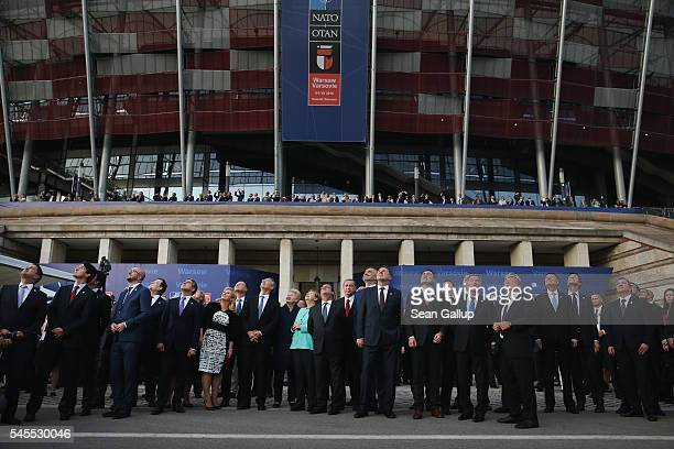 NATO leaders leaders of NATO member states and others watch NATO military aircraft fly past during the Warsaw NATO Summit on July 8 2016 in Warsaw...