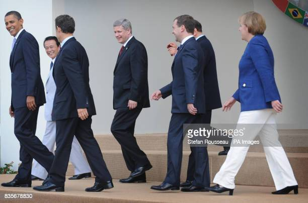 G8 leaders leave the stage after posing for their family photo President of the USA Barack Obama Japanese Prime Minister Taro Aso French President...