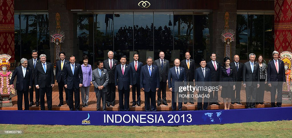 Leaders line up for the traditional 'leaders' family photo' at the Asia-Pacific Economic Cooperation (APEC) Summit in Nusa Dua on the Indonesian resort island of Bali on October 8, 2013. Pictured are (front row L to R) Chilean President Sebastian Pinera, Canadian Prime Minister Stephen Harper, Australia's Prime Minister Tony Abbott, Brunei's Sultan Hassanal Bolkiah, China's President Xi Jinping, Indonesia's President Susilo Bambang Yudhoyono, Russian President Vladimir Putin, Vietnamese Prime Minister Nguyen Tan Dung, Thailand's Prime Minister Yingluck Shinawatra, Singapore's Prime Minister Lee Hsien Loong and US Secretary of State John Kerry; and (second row L to R) Hong Kong Chief Executive Leung Chun-ying, Japan's Prime Minister Shinzo Abe, South Korean President Park Geun-Hye, Malaysia's Prime Minister Najib Razak, Mexico's President Enrique Pena Nieto, New Zealand Prime Minister John Key, Philippine President Benigno Aquino, Vincent Siew, Taiwan's former vice president, Papua New Guinea's Prime Minister Peter O'Neill and Peru's Foreign Minister Eda Rivas.