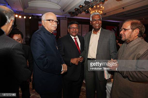 BJP leaders LK Advani Ravi Shankar Prasad CPI leader D Raja and Janta Dal United leader Sharad Yadav attend the 'Ramnath Goenka Excellence in...