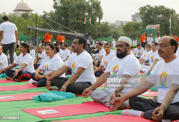 BJP leaders Meenakshi Lekhi Ram Madhav and Vijay Goel participate in a mass yoga performance led by Prime Minister Narendra Modi to mark the...