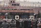 Leaders of Communist Party of the Soviet Union stand together on the rostrum above Lenin's mausoleum to view the funeral procession for Russian...