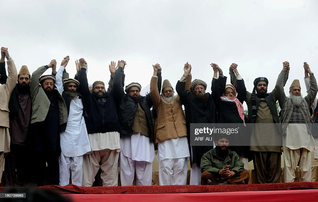 Leaders of Defence of Pakistan Council raise hands in a rally to mark Kashmir Solidarity day in Lahore on February 5, 2013. Pakistan observed Kashmir Solidarity Day on February 5, to denounce Indian rule in the disputed Himalayan region claimed in whole by both countries. AFP PHOTO/Arif ALI