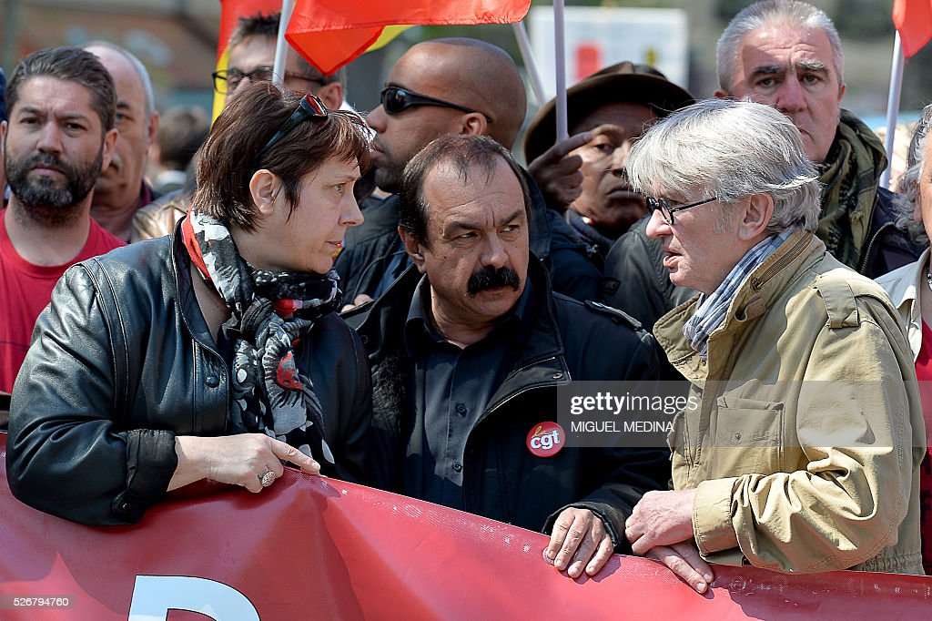 Leaders of French worker's unions, Bernadette Groison of the Federation Syndicale Unitaire (FSU), Philippe Martinez of the General Confederation of Labour (CGT) and Jean-Claude Mailly of Force Ouvriere (FO), hold a banner at the head of a march during a traditional May Day demonstration on May 1, 2016, in Paris.
