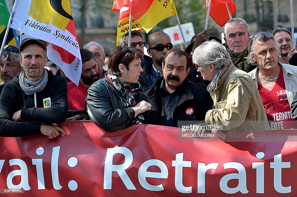 Leaders of French worker's unions, Bernadette Groison (2nd L) of the Federation Syndicale Unitaire (FSU), Philippe Martinez (C) of the General Confederation of Labour (CGT) and Jean-Claude Mailly (2nd R) of Force Ouvriere (FO) hold a banner at the head of a march during a traditional May Day demonstration on May 1, 2016, in Paris.