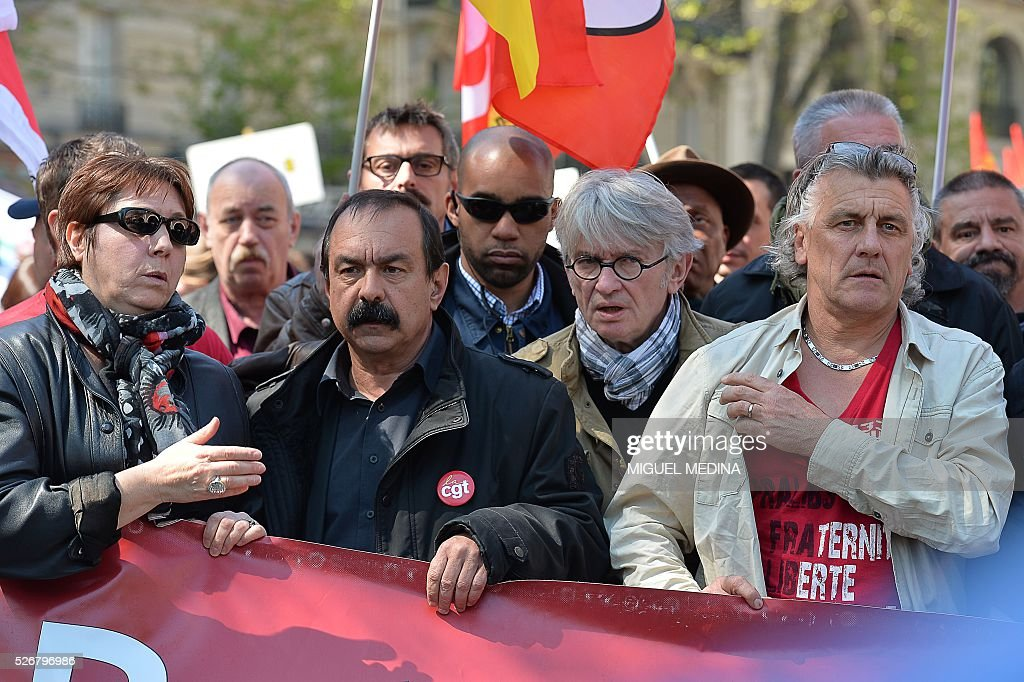 Leaders of French worker's unions Bernadette Groison of the Federation Syndicale Unitaire (FSU), Philippe Martinez of the General Confederation of Labour (CGT) and Jean-Claude Mailly of Force Ouvriere (FO) hold a banner at the head of a march during a traditional May Day demonstration on May 1, 2016, in Paris.