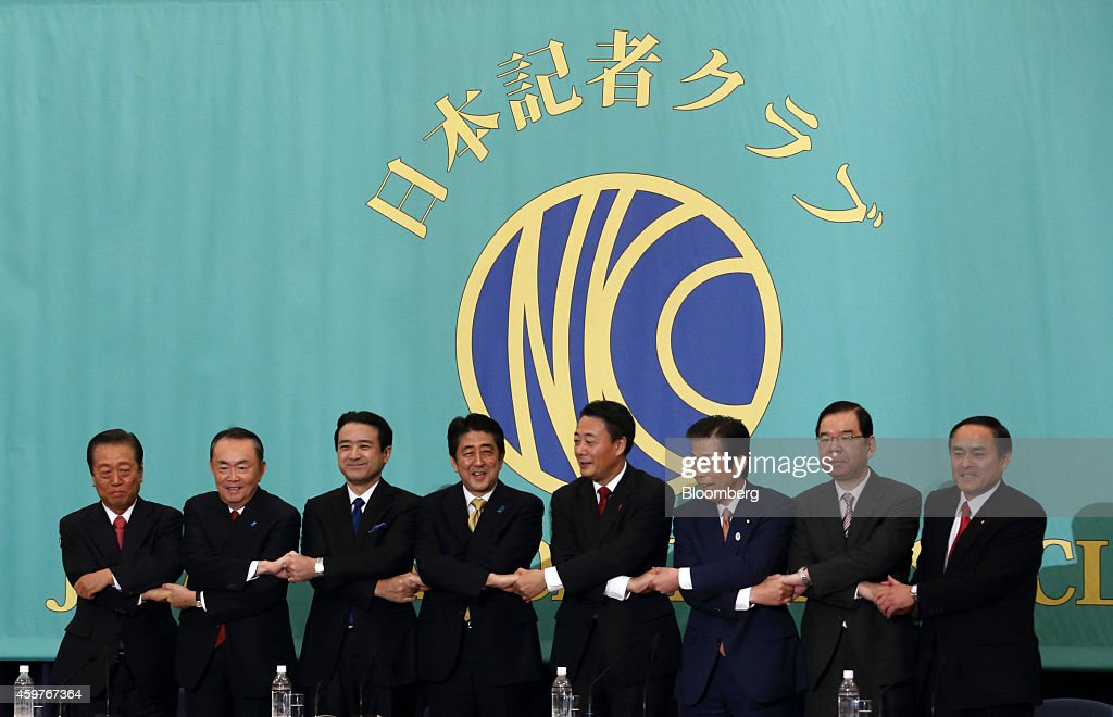 Leaders of Japan's political parties pose for a group photograph before their debate ahead of the Dec. 14 election at the Japan National Press Club in Tokyo, Japan, on Monday, Dec. 1, 2014. <a gi-track='captionPersonalityLinkClicked' href=/galleries/search?phrase=Ichiro+Ozawa&family=editorial&specificpeople=680192 ng-click='$event.stopPropagation()'>Ichiro Ozawa</a>, president of of the People's Life First party, from left, <a gi-track='captionPersonalityLinkClicked' href=/galleries/search?phrase=Takeo+Hiranuma&family=editorial&specificpeople=2078453 ng-click='$event.stopPropagation()'>Takeo Hiranuma</a>, chairperson of the Party for Future Generations, <a gi-track='captionPersonalityLinkClicked' href=/galleries/search?phrase=Kenji+Eda&family=editorial&specificpeople=5666020 ng-click='$event.stopPropagation()'>Kenji Eda</a>, co-leader of the Japan Innovation Party, <a gi-track='captionPersonalityLinkClicked' href=/galleries/search?phrase=Shinzo+Abe&family=editorial&specificpeople=559017 ng-click='$event.stopPropagation()'>Shinzo Abe</a>, Japan's prime minister and president of the Liberal Democratic Party (LDP), <a gi-track='captionPersonalityLinkClicked' href=/galleries/search?phrase=Banri+Kaieda&family=editorial&specificpeople=7193235 ng-click='$event.stopPropagation()'>Banri Kaieda</a>, president of the Democratic Party of Japan (DPJ), <a gi-track='captionPersonalityLinkClicked' href=/galleries/search?phrase=Natsuo+Yamaguchi&family=editorial&specificpeople=5718603 ng-click='$event.stopPropagation()'>Natsuo Yamaguchi</a>, president of the New Komeito party, <a gi-track='captionPersonalityLinkClicked' href=/galleries/search?phrase=Kazuo+Shii&family=editorial&specificpeople=2255749 ng-click='$event.stopPropagation()'>Kazuo Shii</a>, chairman of the Japanese Communist Party, and Tadatomo Yoshidoa, leader of the Social Democratic Party. The economy will matter more to Japanese voters than security and nuclear policies when they cast their votes in the Dec. 14 election, media polls showed. Photographer: Tomohiro Ohsumi/Bloomberg via Getty Images