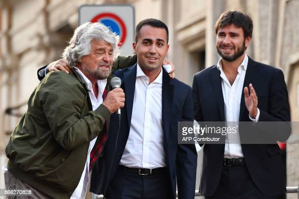 Leaders of the antiestablishment Five Star Movement Beppe Grillo Luigi Di Maio and Alessandro Di Battista address supporters during a protest near...