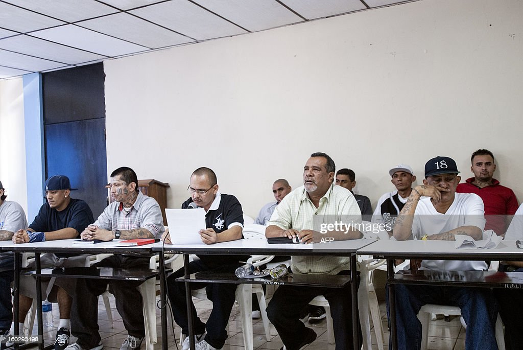 Leaders of the five gangs --Mara Salvatrucha (MS-13), Barrio 18, MAO-MAO, Máquina and Mirada Locos-- attend a press conference to demand the US to support the truce they started on 2012 --which had already lowered the daily murder rate from 14 to 5-- on January 28, 2013 at La Esperanza prison in San Salvador. The US State Department recently issued a travel warning to US citizens about the security situation in El Salvador. The leaders have assured tourists their safety and well-being while visiting the country and have given instructions to their members to respect them. AFP PHOTO/ Juan CARLOS