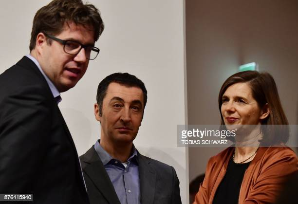 Leaders of the German Green Party Katrin GoeringEckardt and Cem Ozdemir wait to speak after exploratory talks on forming a new government broke down...