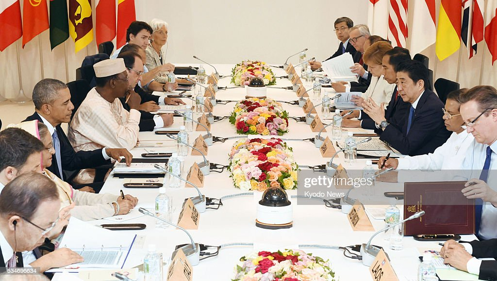 Leaders of the Group of Seven major economies and their counterparts from Indonesia, Laos, Vietnam as well as four other non-G-7 countries attend an outreach session in the central Japan city of Shima on May 27, 2016.