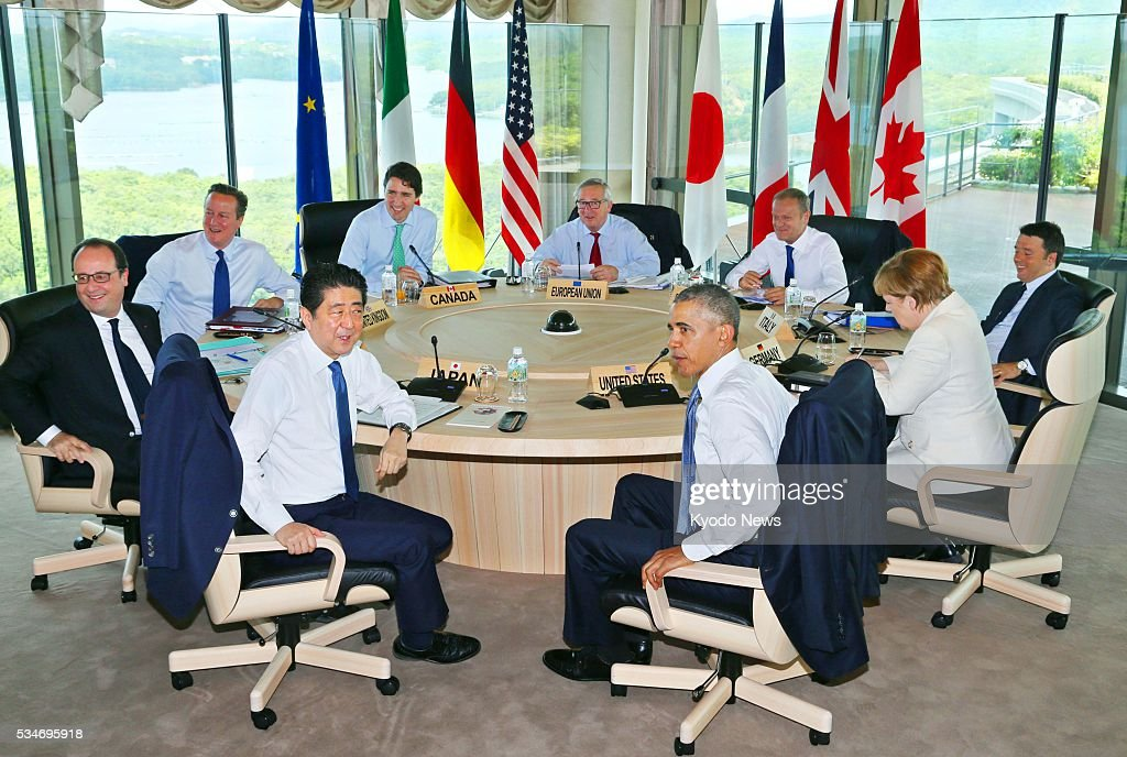 Leaders of the Group of Seven major economies -- (clockwise from front L) Japanese Prime Minister <a gi-track='captionPersonalityLinkClicked' href=/galleries/search?phrase=Shinzo+Abe&family=editorial&specificpeople=559017 ng-click='$event.stopPropagation()'>Shinzo Abe</a>, French President Francois Hollande, British Prime Minister <a gi-track='captionPersonalityLinkClicked' href=/galleries/search?phrase=David+Cameron+-+Homme+politique&family=editorial&specificpeople=227076 ng-click='$event.stopPropagation()'>David Cameron</a>, Canadian Prime Minister <a gi-track='captionPersonalityLinkClicked' href=/galleries/search?phrase=Justin+Trudeau&family=editorial&specificpeople=2616495 ng-click='$event.stopPropagation()'>Justin Trudeau</a>, European Commission President <a gi-track='captionPersonalityLinkClicked' href=/galleries/search?phrase=Jean-Claude+Juncker&family=editorial&specificpeople=207032 ng-click='$event.stopPropagation()'>Jean-Claude Juncker</a>, European Council President <a gi-track='captionPersonalityLinkClicked' href=/galleries/search?phrase=Donald+Tusk&family=editorial&specificpeople=870281 ng-click='$event.stopPropagation()'>Donald Tusk</a>, Italian Prime Minister <a gi-track='captionPersonalityLinkClicked' href=/galleries/search?phrase=Matteo+Renzi&family=editorial&specificpeople=6689301 ng-click='$event.stopPropagation()'>Matteo Renzi</a>, German Chancellor <a gi-track='captionPersonalityLinkClicked' href=/galleries/search?phrase=Angela+Merkel&family=editorial&specificpeople=202161 ng-click='$event.stopPropagation()'>Angela Merkel</a> and U.S. President <a gi-track='captionPersonalityLinkClicked' href=/galleries/search?phrase=Barack+Obama&family=editorial&specificpeople=203260 ng-click='$event.stopPropagation()'>Barack Obama</a> -- attend a meeting on the second of their summit meeting in the central Japan city of Shima on May 27, 2016.