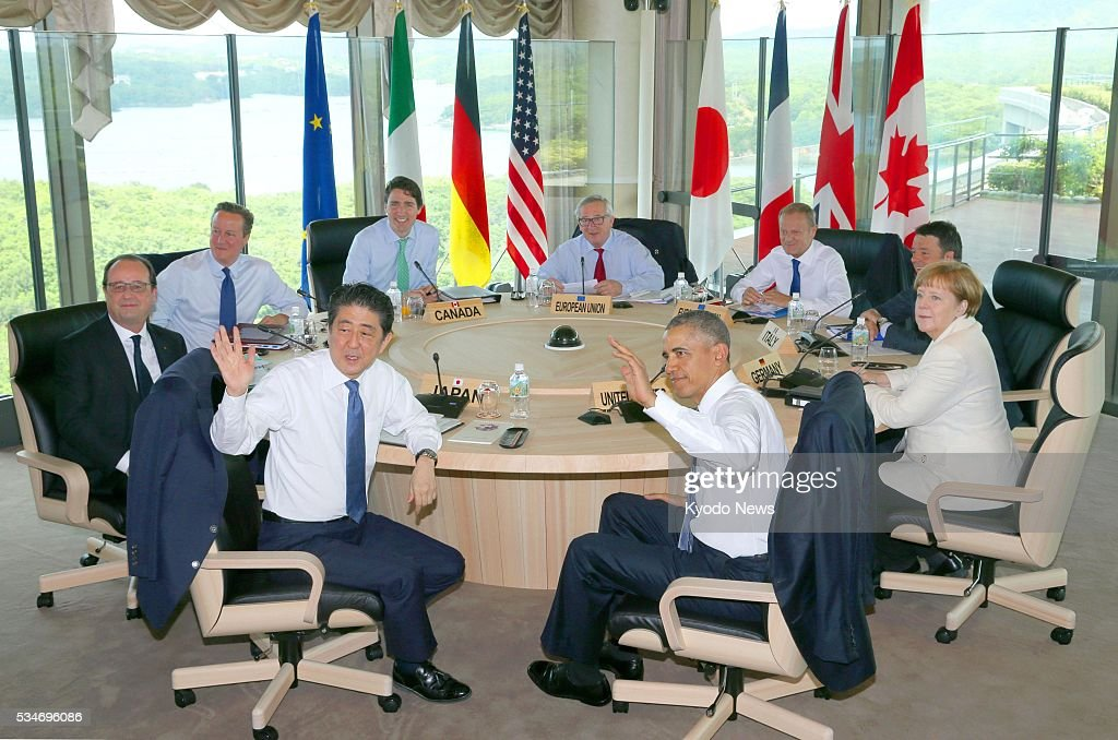 Leaders of the Group of Seven major economies -- (clockwise from front L) Japanese Prime Minister <a gi-track='captionPersonalityLinkClicked' href=/galleries/search?phrase=Shinzo+Abe&family=editorial&specificpeople=559017 ng-click='$event.stopPropagation()'>Shinzo Abe</a>, French President Francois Hollande, British Prime Minister <a gi-track='captionPersonalityLinkClicked' href=/galleries/search?phrase=David+Cameron+-+Pol%C3%ADtico&family=editorial&specificpeople=227076 ng-click='$event.stopPropagation()'>David Cameron</a>, Canadian Prime Minister <a gi-track='captionPersonalityLinkClicked' href=/galleries/search?phrase=Justin+Trudeau&family=editorial&specificpeople=2616495 ng-click='$event.stopPropagation()'>Justin Trudeau</a>, European Commission President <a gi-track='captionPersonalityLinkClicked' href=/galleries/search?phrase=Jean-Claude+Juncker&family=editorial&specificpeople=207032 ng-click='$event.stopPropagation()'>Jean-Claude Juncker</a>, European Council President Donald Tusk, Italian Prime Minister <a gi-track='captionPersonalityLinkClicked' href=/galleries/search?phrase=Matteo+Renzi&family=editorial&specificpeople=6689301 ng-click='$event.stopPropagation()'>Matteo Renzi</a>, German Chancellor <a gi-track='captionPersonalityLinkClicked' href=/galleries/search?phrase=Angela+Merkel&family=editorial&specificpeople=202161 ng-click='$event.stopPropagation()'>Angela Merkel</a> and U.S. President <a gi-track='captionPersonalityLinkClicked' href=/galleries/search?phrase=Barack+Obama&family=editorial&specificpeople=203260 ng-click='$event.stopPropagation()'>Barack Obama</a> -- attend a meeting on the second of their summit meeting in the central Japan city of Shima on May 27, 2016.