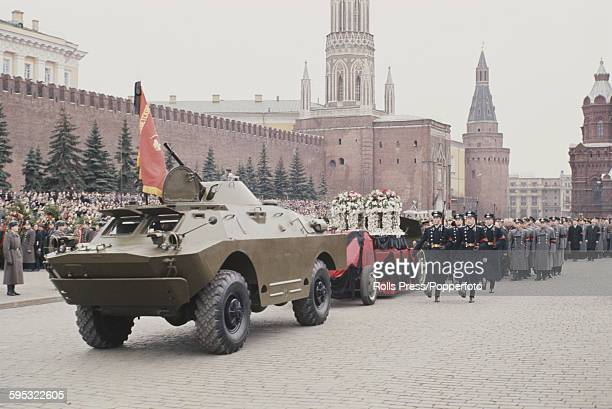 Leaders of the Soviet Union follow the funeral procession for Russian cosmonaut Yuri Gagarin whose flower draped coffin is carried on a gun carriage...