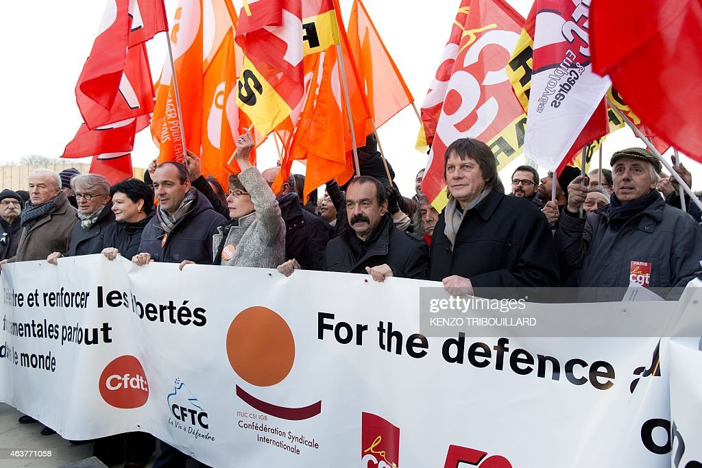 Leaders of workers trade unions (LtoR) Secretary General of Force Ouvriere (FO) <a gi-track='captionPersonalityLinkClicked' href=/galleries/search?phrase=Jean-Claude+Mailly&family=editorial&specificpeople=619111 ng-click='$event.stopPropagation()'>Jean-Claude Mailly</a> (2nd), General Secretary of the International Trade Union Confederation (ITUC) Sharan Burrow (3rd), Secretary General of CFDT Laurent Berger (4th), newly elected CGT Secretary General Philippe Martinez (6th) and his predecessor <a gi-track='captionPersonalityLinkClicked' href=/galleries/search?phrase=Bernard+Thibault&family=editorial&specificpeople=658517 ng-click='$event.stopPropagation()'>Bernard Thibault</a> (7th) take part in a demonstration as part of a global day of action to defend their right to strike, on February 18, 2015 in Paris. French Economy Minister Emmanuel Macron is trying to push through a controversial series of laws that he hopes will, in his words, 'unblock' France's economy, which is suffering from high unemployment and sluggish growth.