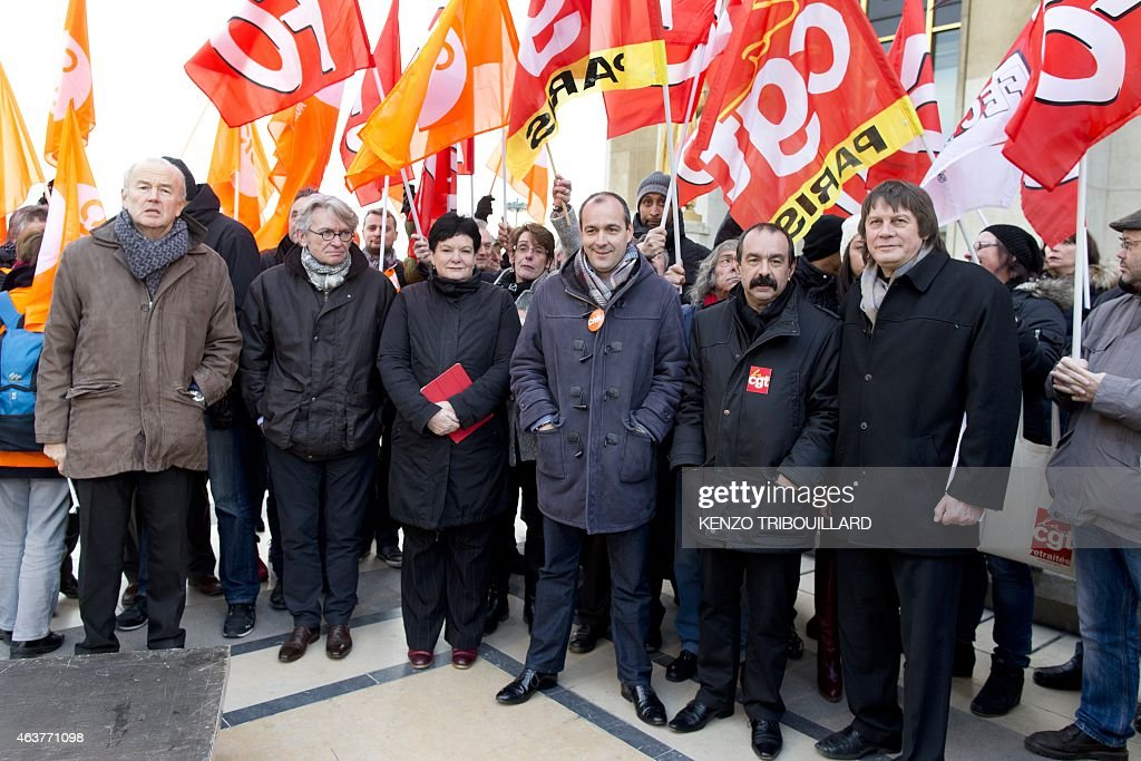 Leaders of workers trade unions (LtoR) Secretary General of Force Ouvriere (FO) <a gi-track='captionPersonalityLinkClicked' href=/galleries/search?phrase=Jean-Claude+Mailly&family=editorial&specificpeople=619111 ng-click='$event.stopPropagation()'>Jean-Claude Mailly</a> (2nd), Secretary General of the International Trade Union Confederation (ITUC) Sharan Burrow (3rd), Secretary General of CFDT Laurent Berger (4th), newly elected CGT Secretary General <a gi-track='captionPersonalityLinkClicked' href=/galleries/search?phrase=Philippe+Martinez&family=editorial&specificpeople=662194 ng-click='$event.stopPropagation()'>Philippe Martinez</a> (5th) and his predecessor <a gi-track='captionPersonalityLinkClicked' href=/galleries/search?phrase=Bernard+Thibault&family=editorial&specificpeople=658517 ng-click='$event.stopPropagation()'>Bernard Thibault</a> (6th) pose as they take part in a demonstration as part of a global day of action to defend their right to strike, on February 18, 2015 in Paris. French Economy Minister Emmanuel Macron is trying to push through a controversial series of laws that he hopes will, in his words, 'unblock' France's economy, which is suffering from high unemployment and sluggish growth.
