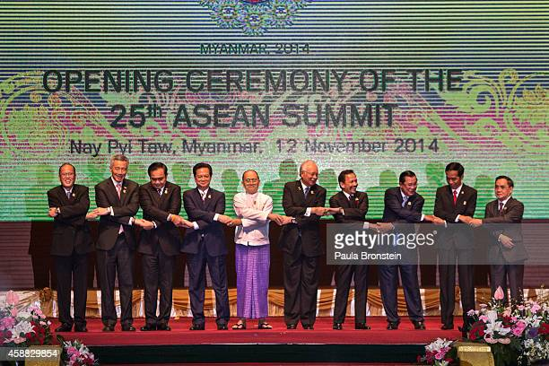 Leaders pose at the Opening Ceremony of the summit on November 12 2014 in Naypyidaw Myanmar Myanmar's capitol Naypyidaw is hosting the 25th...