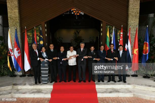 Leaders pose for a 'family photo' at Association of Southeast Asian Nations leaders' summit in Manila on April 29 2017 Philippine President Rodrigo...