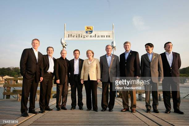 G8 leaders pose for a group photograph on a sea front pier British Prime Minister Tony Blair Italian Prime Minister Romano Prodi Russian President...