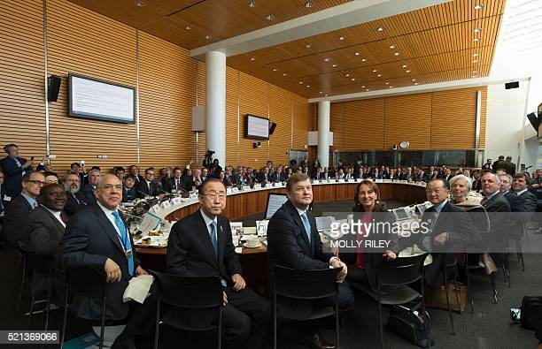 Leaders pose for a photo prior to the Carbon Pricing Leadership Coalition Assembly during the IMF and World Bank Group 2016 Spring Meetings on April...