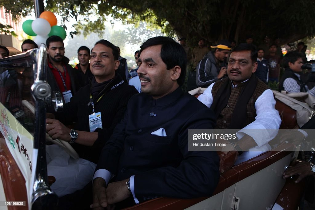 BJP leaders Rajeev Pratap Rudy and Shah Nawaj Hussein taking part in Vintage car rally organised by the JK Tyre and Constitution Club of India on December 8, 2012 in New Delhi, India.