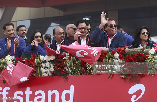 BJP leaders Rajiv Pratap Rudy Neelam Pratap Rudy Vijay Goel Minister of State for Home Affairs Kiren Rijiju and actorpolitician Vinod Khanna cheer...