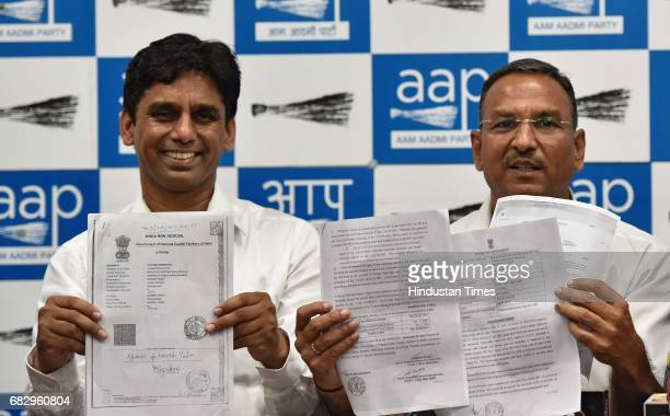 AAP leaders Ramcharan Goel and Naresh Yadav during a press conference at AAP Office on May 14 2017 in New Delhi India Sanjay Singh slammed the BJP...