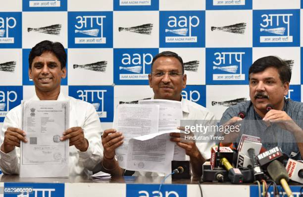 AAP leaders Ramcharan Goel Naresh Yadav and Sanjay Singh during a press conference at AAP Office on May 14 2017 in New Delhi India Sanjay Singh...