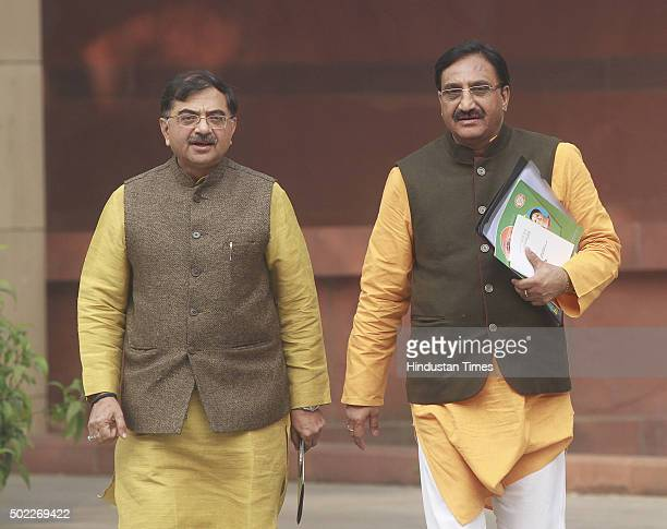 BJP leaders Ramesh Pokhriyal and Tarun Vijay after the BJP parliamentary board meeting on December 22 2015 in New Delhi India Parliament passed the...