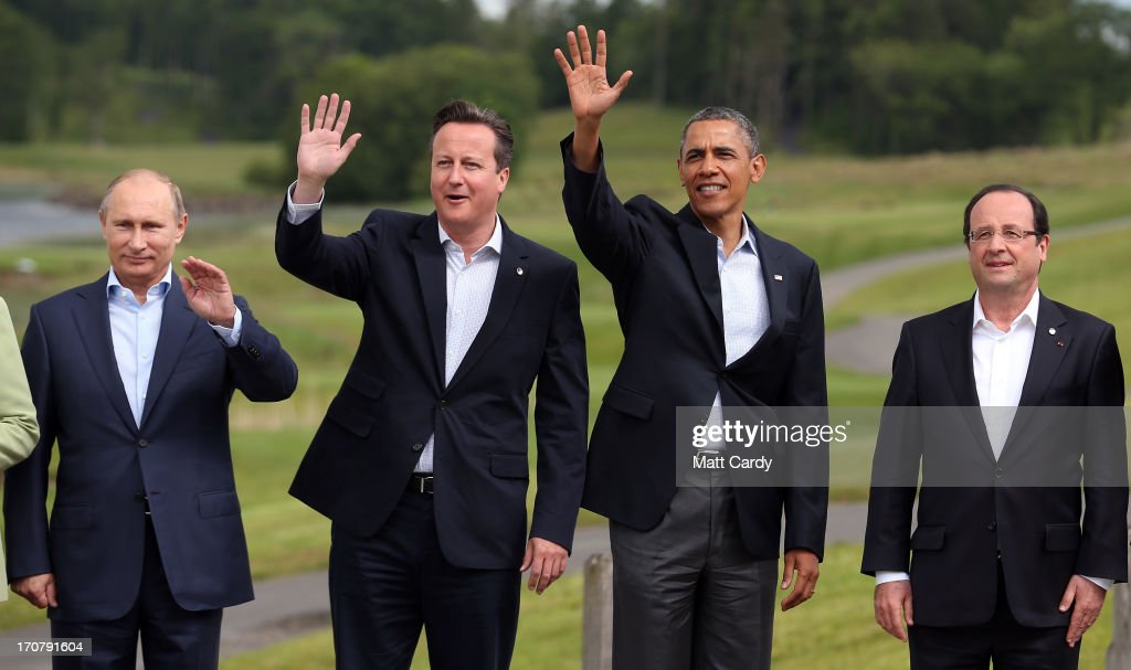 Leaders (L-R) Russia's President Vladimir Putin, Britain's Prime Minister David Cameron, US President Barack Obama and French President Francois Hollande stand for the 'family' group photograph at the G8 venue of Lough Erne on June 18, 2013 in Enniskillen, Northern Ireland. The two day G8 summit, hosted by UK Prime Minister David Cameron, is being held in Northern Ireland for the first time. Leaders from the G8 nations have gathered to discuss numerous topics with the situation in Syria expected to dominate the talks.