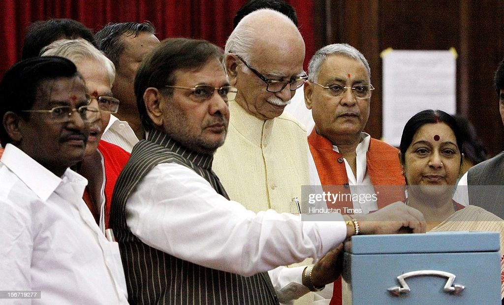 'NEW DELHI, INDIA - AUGUST 7: NDA leaders Sharad Yadav L K Advani and Sushma Swaraj casting vote for the election of Vice President at Parliament house on August 7, 2012 in New Delhi, India. (Photo by Sunil Saxena/Hindustan Times via Getty Images)'