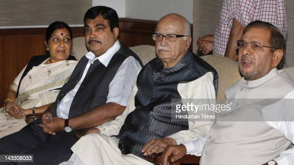 NDA leaders Sushma Swaraj Nitin Gadkari L K Advani and Sharad Yadav attend the NDA meeting at Advani's residence on April 23 2012 in New Delhi India...