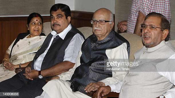 NDA leaders Sushma Swaraj Nitin Gadkari L K Advani and Sharad Yadav attend the NDA meeting at Advani's residence on April 23 2012 in New Delhi India...