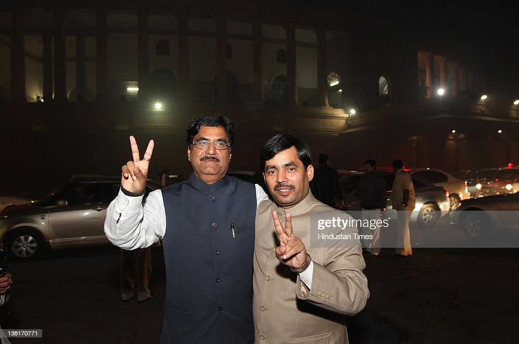 BJP leaders Syed Shahnawaz Hussain and <a gi-track='captionPersonalityLinkClicked' href=/galleries/search?phrase=Gopinath+Munde&family=editorial&specificpeople=652850 ng-click='$event.stopPropagation()'>Gopinath Munde</a> dispaly a victory sign after the voting on Lokpal Bill in Lok Sabha at Parliament house on December 27, 2011 in New Delhi, India. The Lokpal bill was passed by voice vote with 10 amendments, however the Left parties, SP and BSP walked out in protest before the voting.
