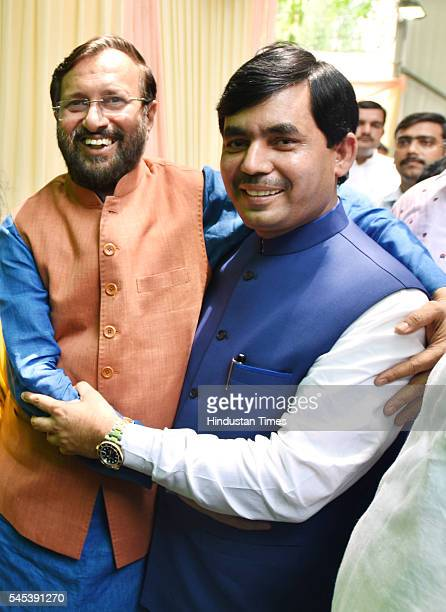 BJP leaders Syed Shahnawaz Hussain and HRD Minister Prakash Javadekar during the Iftar Party at his residence at Pandit Pant Marg on July 7 2016 in...