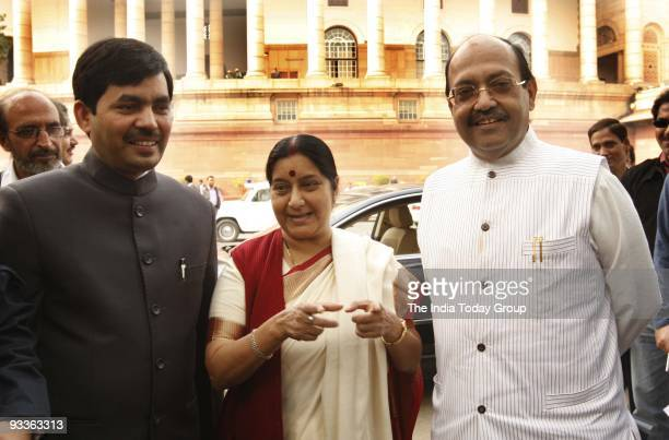 BJP leaders Syed Shahnawaz Hussain Sushma Swaraj and Samajwadi Party Amar Singh at Parliament House in New Delhi on Monday November 23 2009