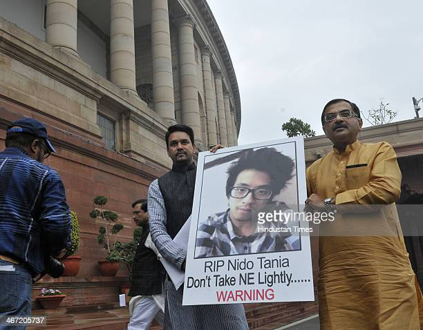 BJP leaders Tarun Vijay and Anurag Thakur holding a poster of Arunachal Pradesh student Nido Tania who was killed recently in New Delhi at Parliament...