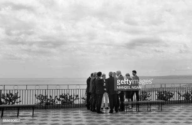 G7 leaders turn from a scenic overlook after walking through town during the G7 Summit in Taormina Italy on May 26 2017 / AFP PHOTO / MANDEL NGAN