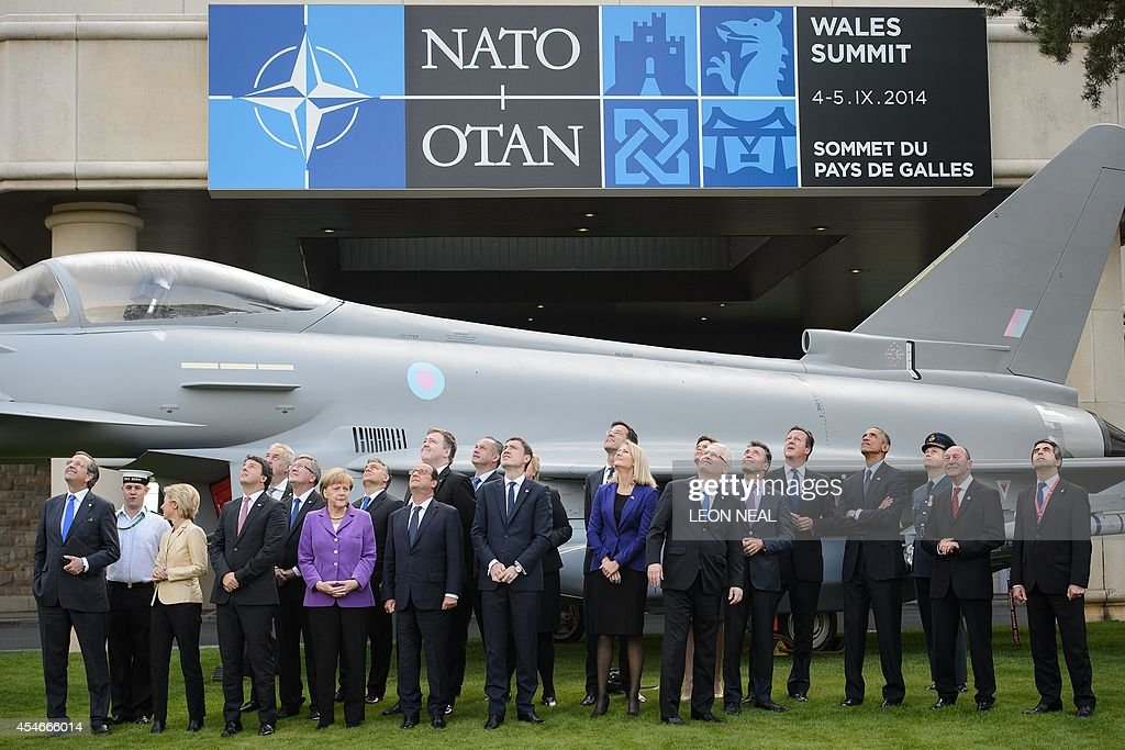 Leaders watch a flypast of military aircraft on the second day of the NATO 2014 Summit at the Celtic Manor Resort in Newport South Wales on September...