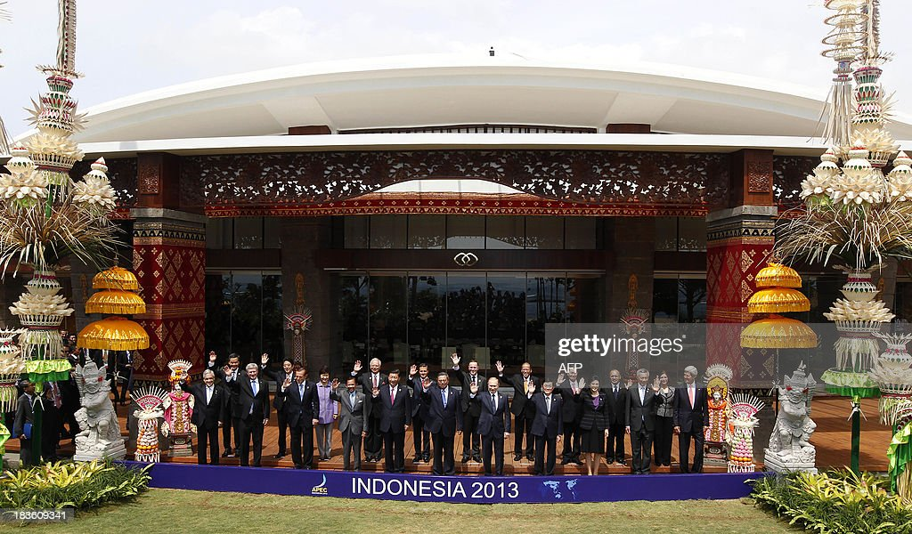 Leaders wave for the traditional 'leaders' family photo' on the final day of the Asia-Pacific Economic Cooperation (APEC) Summit in Nusa Dua on the Indonesian resort island of Bali on October 8, 2013. Pictured are (front row L to R) Chilean President Sebastian Pinera, Canadian Prime Minister Stephen Harper, Australia's Prime Minister Tony Abbott, Brunei's Sultan Hassanal Bolkiah, China's President Xi Jinping, Indonesia's President Susilo Bambang Yudhoyono, Russian President Vladimir Putin, Vietnamese Prime Minister Nguyen Tan Dung, Thailand's Prime Minister Yingluck Shinawatra, Singapore's Prime Minister Lee Hsien Loong and US Secretary of State John Kerry; and (second row L to R) Hong Kong Chief Executive Leung Chun-ying, Japan's Prime Minister Shinzo Abe, South Korean President Park Geun-Hye, Malaysia's Prime Minister Najib Razak, Mexico's President Enrique Pena Nieto, New Zealand Prime Minister John Key, Philippine President Benigno Aquino, Vincent Siew, Taiwan's former vice president, Papua New Guinea's Prime Minister Peter O'Neill and Peru's Foreign Minister Eda Rivas.