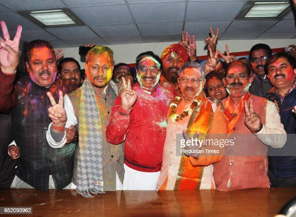 BJP leaders with Shyam Jaju and Ramesh Pokhriyal Nishank celebrating after landslide victory in Uttar Pradesh and Uttarakhand assembly elections at...
